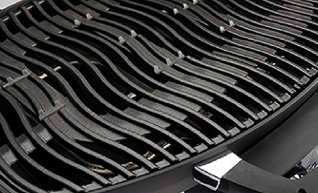 A gas grill has a grate made of porcelainized cast iron.