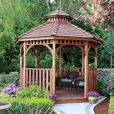 A wood gazebo in a garden.