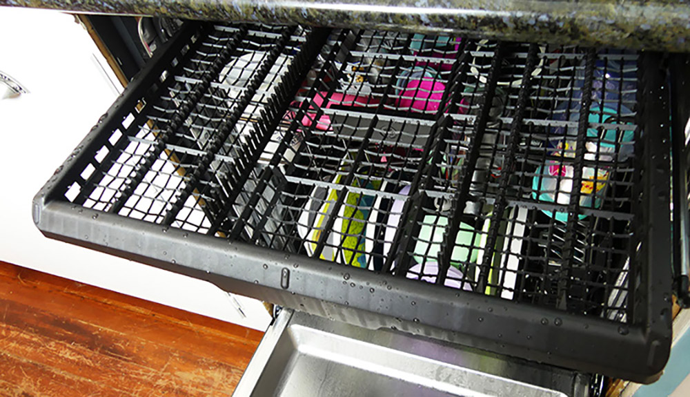 A dishwasher with an extended third rack.