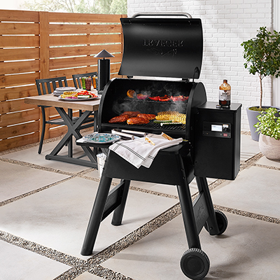 A grill on a patio deck