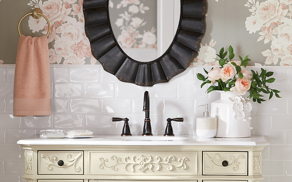 guest bathroom with wallpaper and flower decor