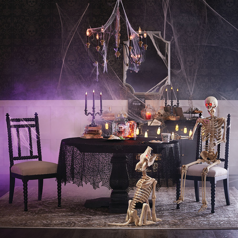 halloween dining display with human and animal skeletons