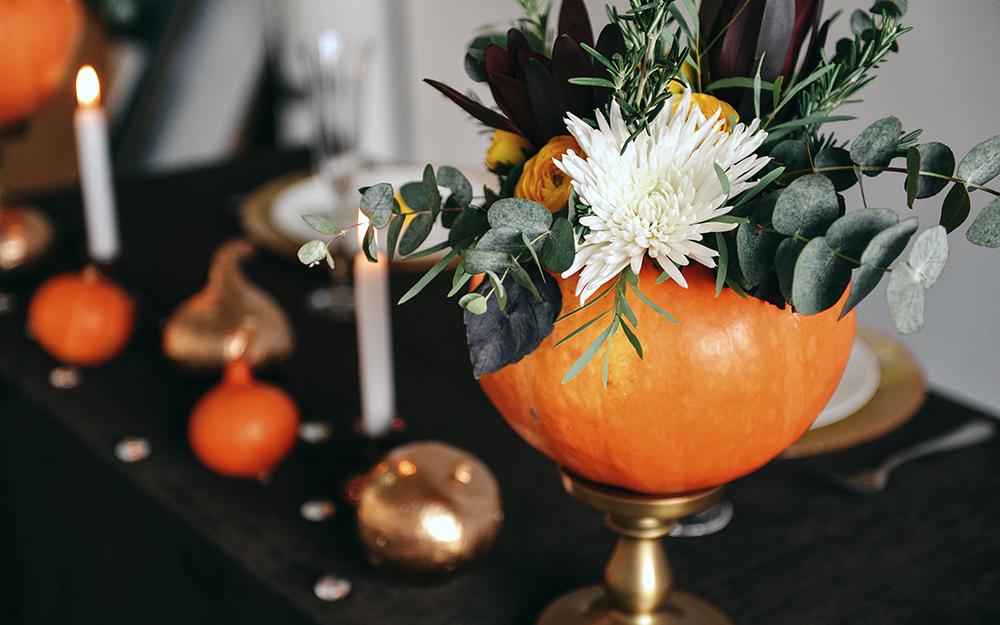 A floral arrangement in a pumpkin.