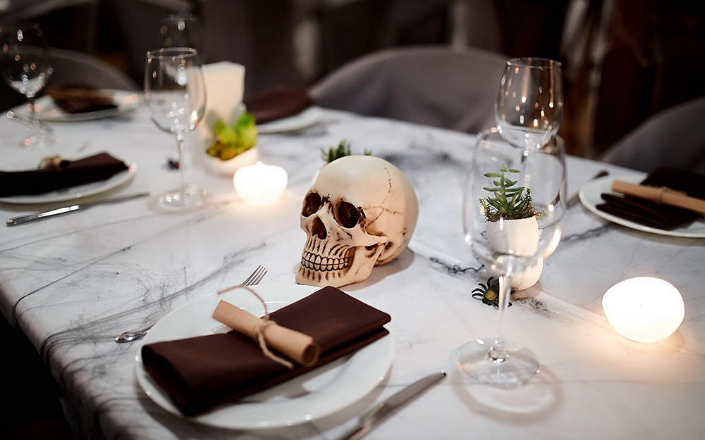 A table with a skull centerpiece.