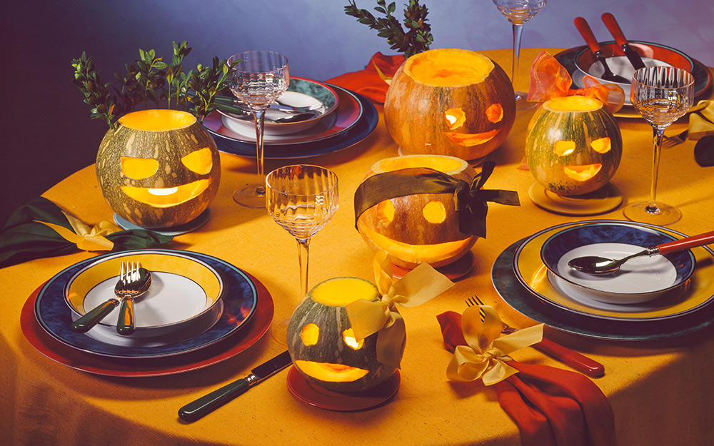 A table with jack o' lanterns on top.