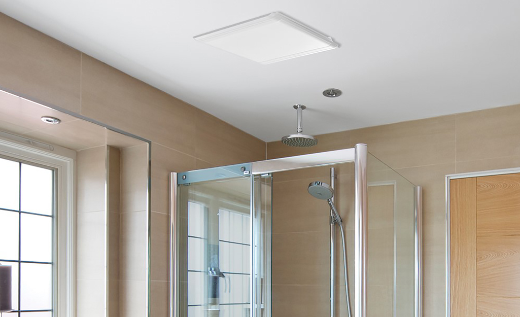 A bathroom with a Hampton Bay bath fan in the ceiling.