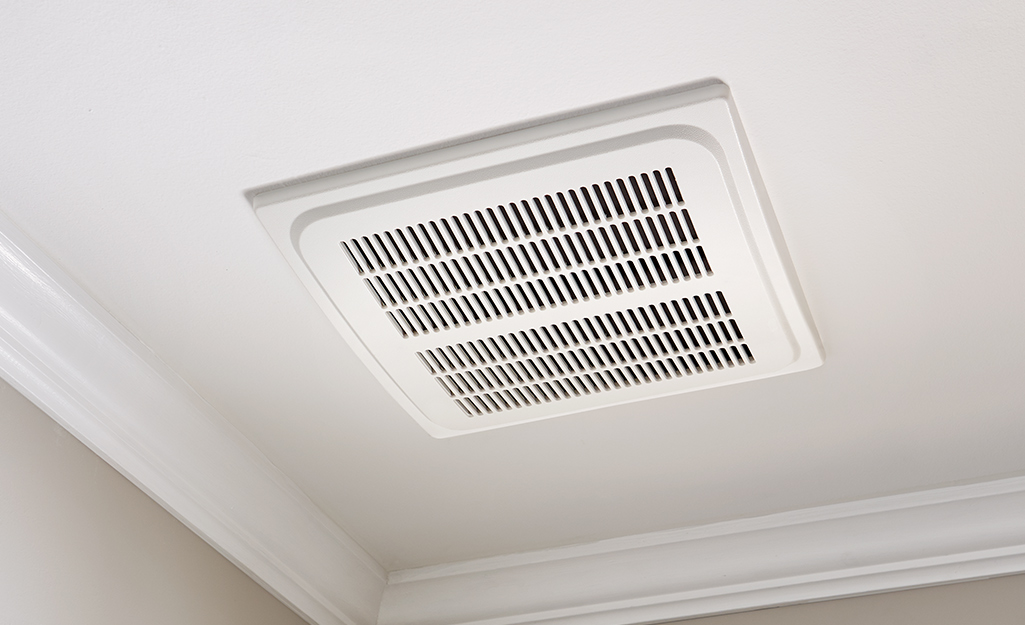 A Hampton Bay bath fan installed in a ceiling.