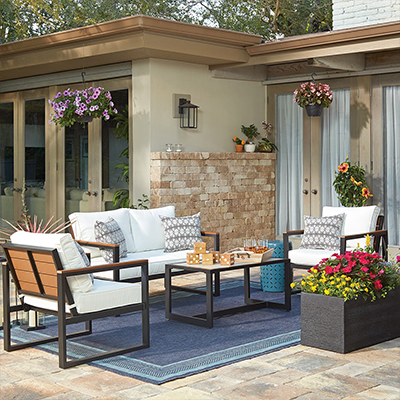 A patio outfitted with a Hampton Bay patio furniture set.