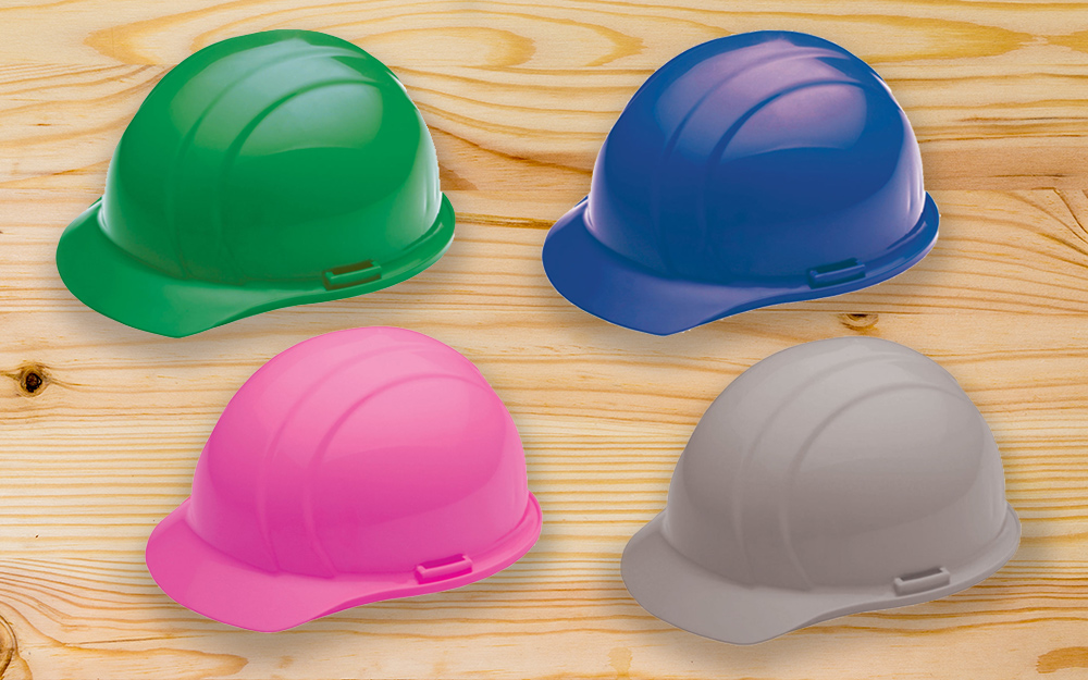 green, blue, pink and gray protective hats