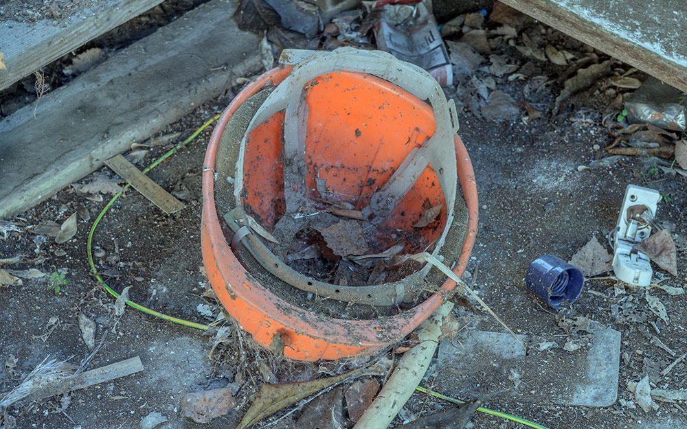 a dirty and expired hard hat
