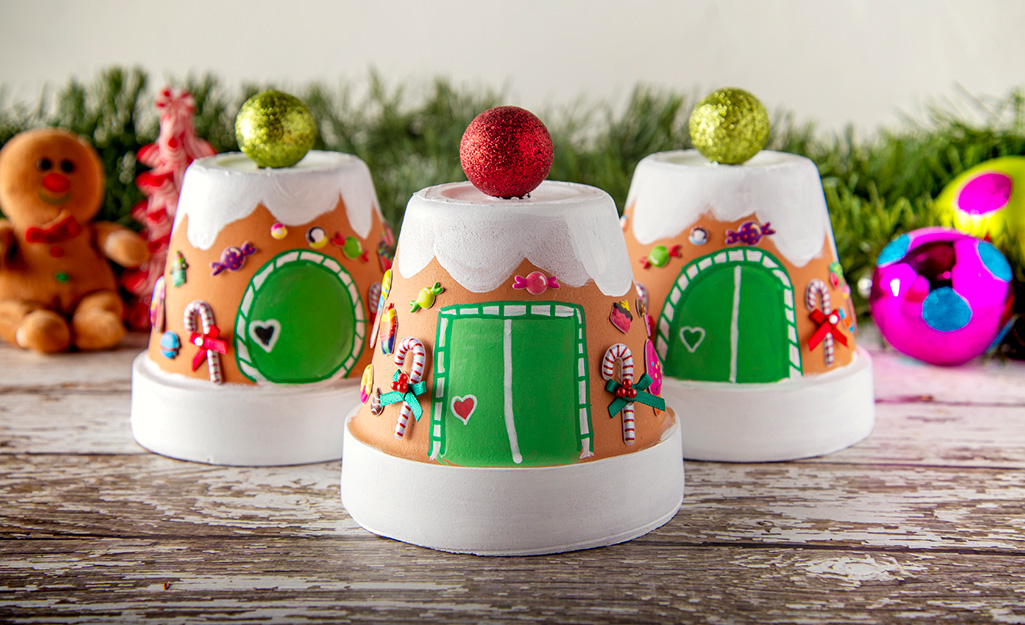 A gingerbread village is created out of terra cotta pots.