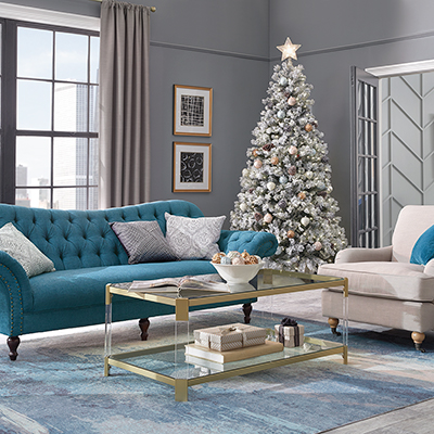 A city apartment living room with a decorated Christmas tree.