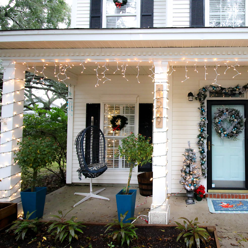 A holiday porch decorated with icicle lights.