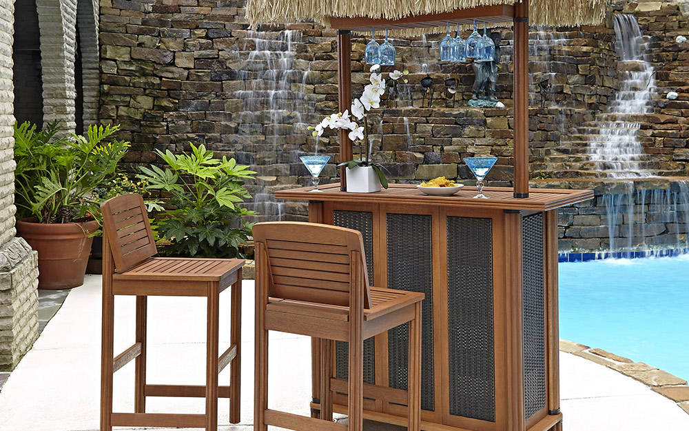 An outdoor home bar by a pool.