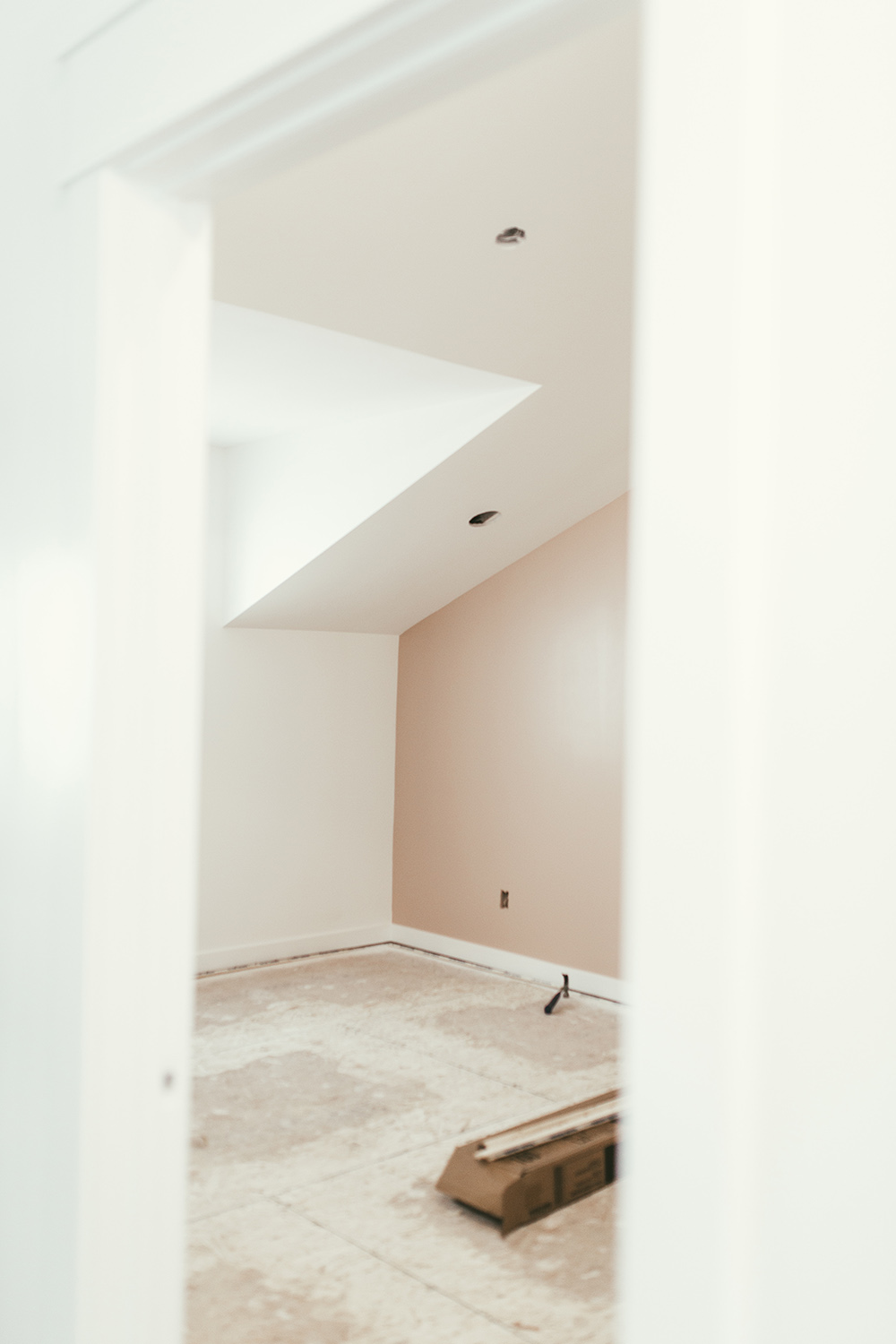 An empty bedroom with no carpet