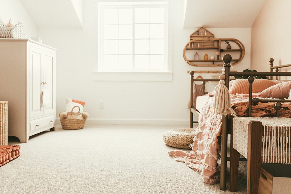 A bedroom with a bed and dresser