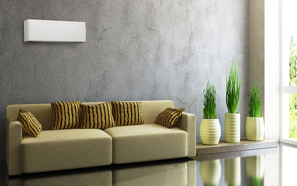 A living room featuring a ductless mini split air conditioner on the wall.