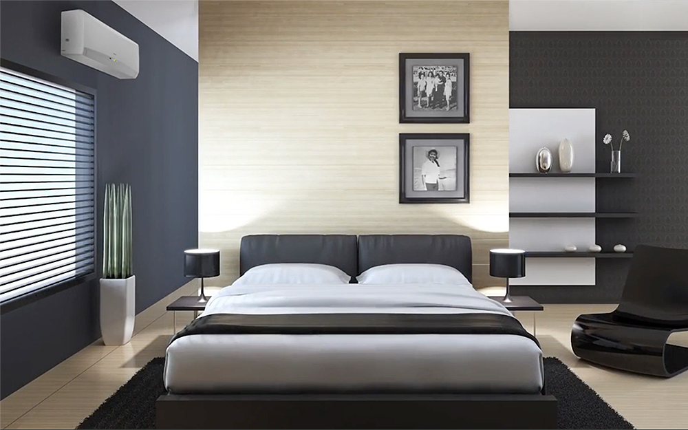 A modern style master bedroom with a mini split on the wall.