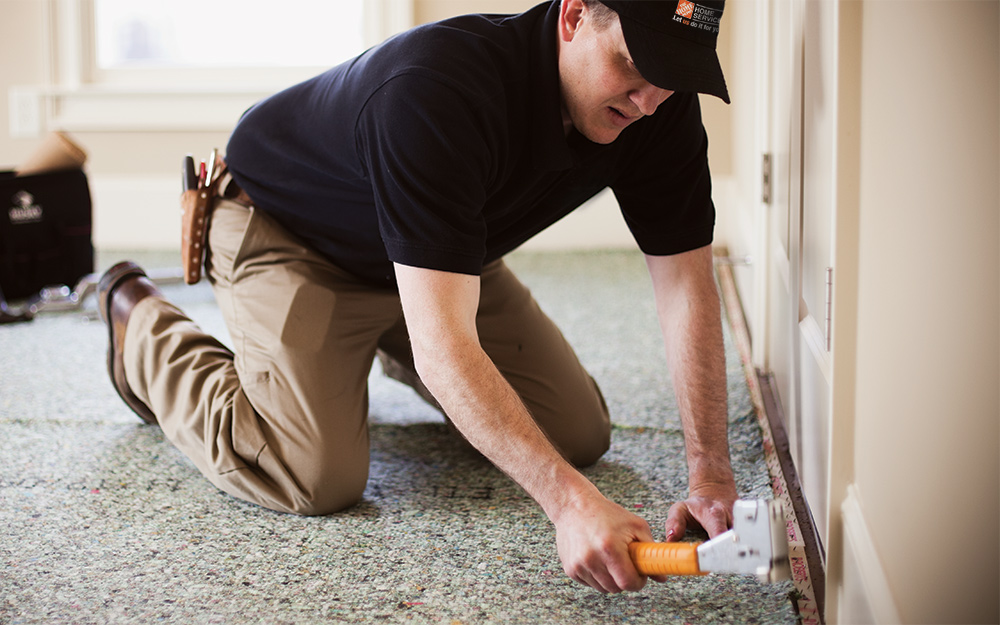 An Installer Placing Carpet Padding In A Room