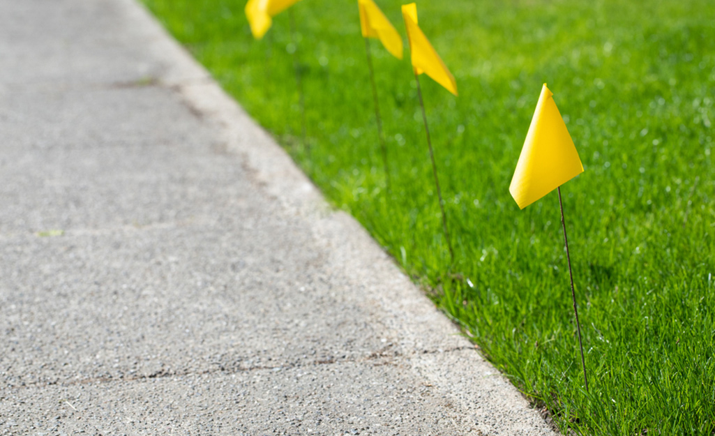 Person aerating lawn with lawn aerator.