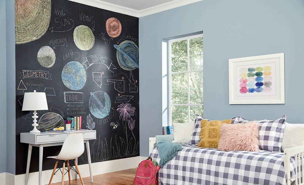A finished chalkboard wall in a child's room.
