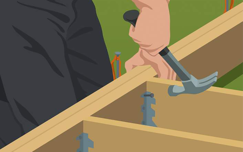 Inner joist attached to beam with hammer and nail.