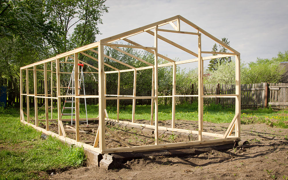Greenhouse built with a timber frame before walls are added.