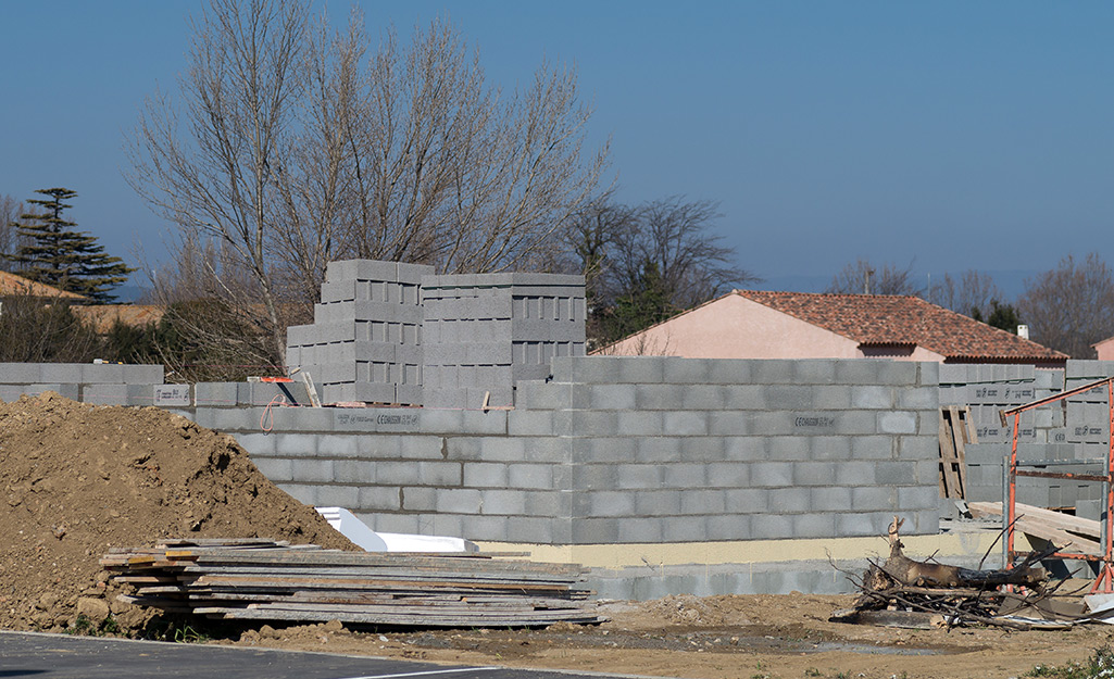 A wall made from cinder blocks for the foundation of a home.