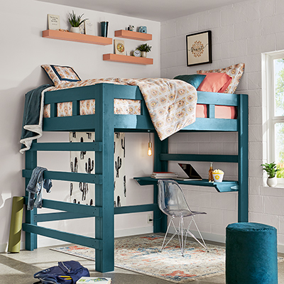A loft bed in a dorm room.