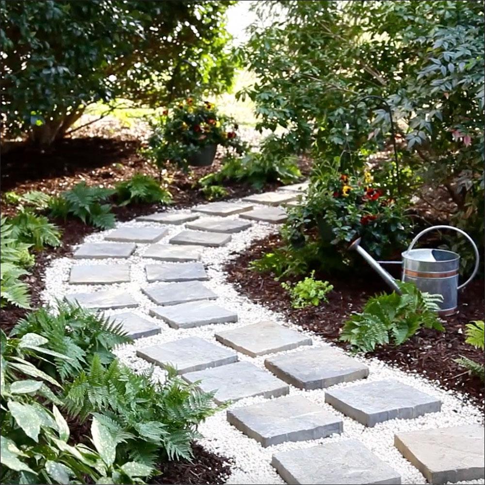 A curving paver path through a home landscape.