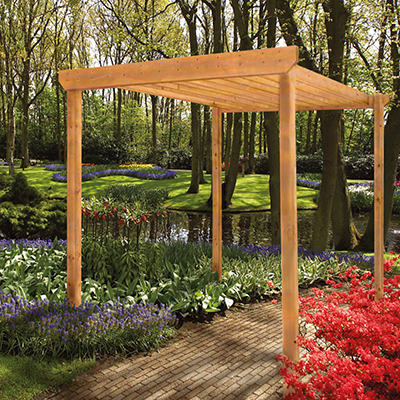 A wood pergola in a backyard.
