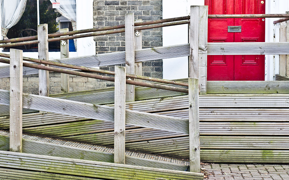 A wheelchair ramp with a switchback turn.