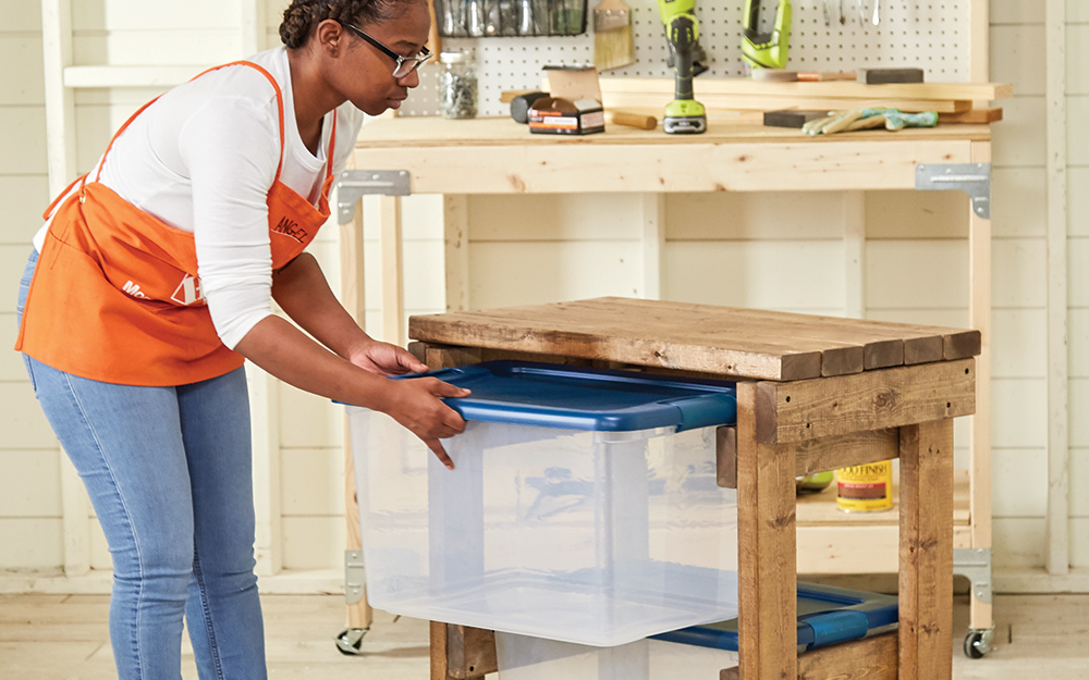 Woman inserts clear storage bins into the finished project.