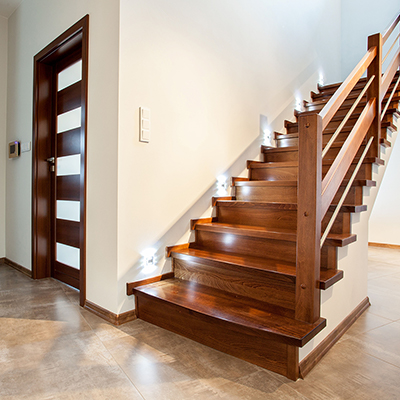 A wood staircase installed in a foyer.