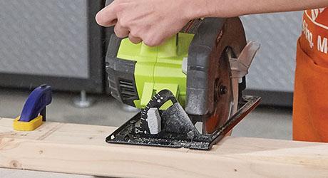 Person cutting lumber using a circular saw
