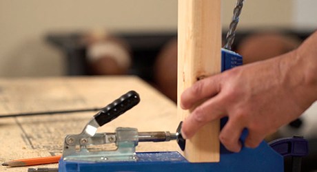 Use a jig to create pocket holes in the frame pieces to make the joining secure.
