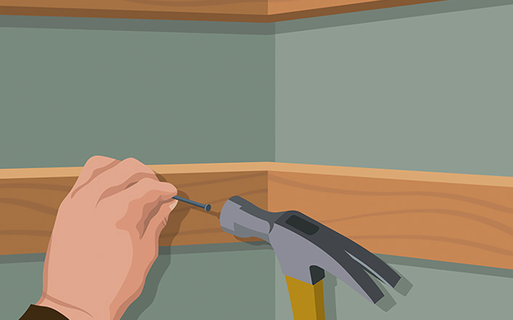 This picture shows you how to hammer in the bottom supports for your DIY closet organizer to the studs in the wall. - Build Closet Organizer