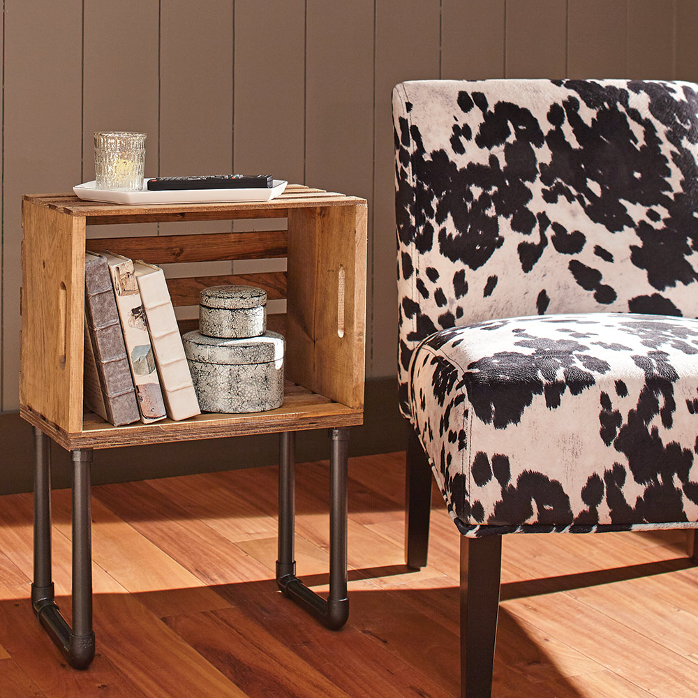 A DIY crate end table provides extra storage in a living room.