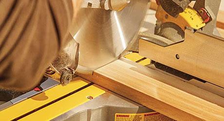 A circular saw cutting into a piece of lumber