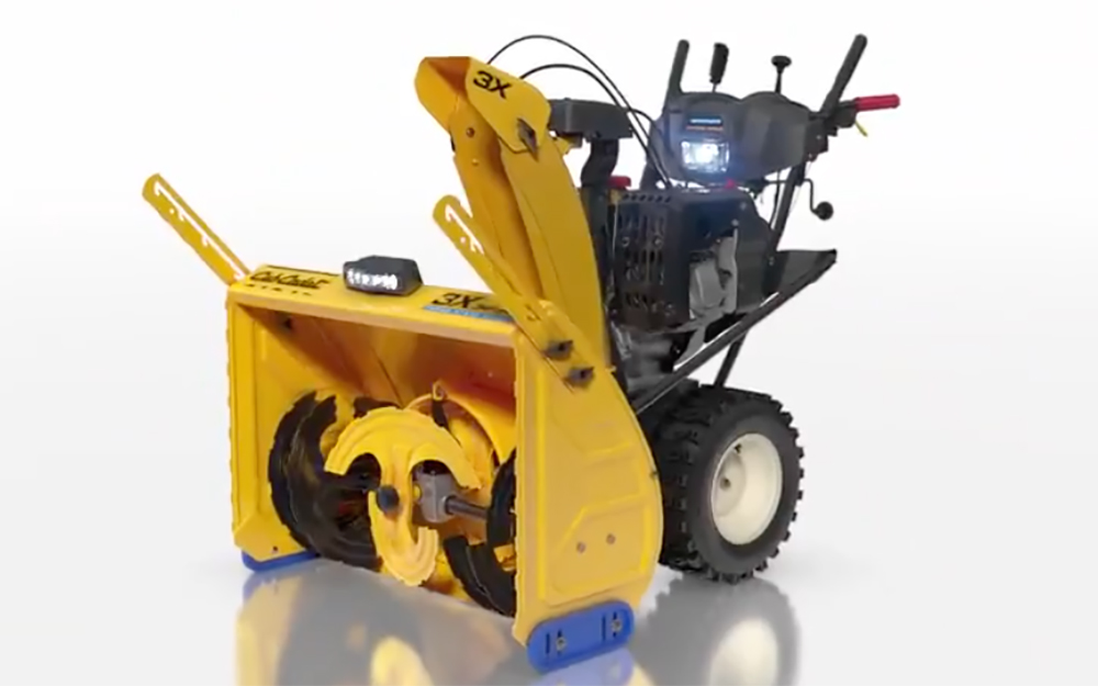 An image of a yellow snow thrower.