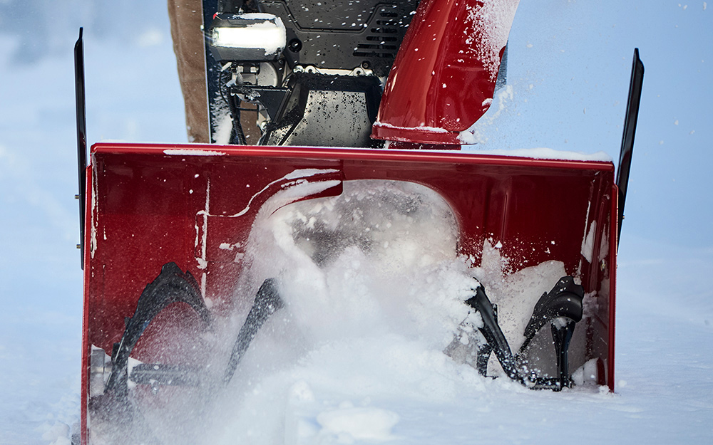 Detail of a snow thrower headlight and loader