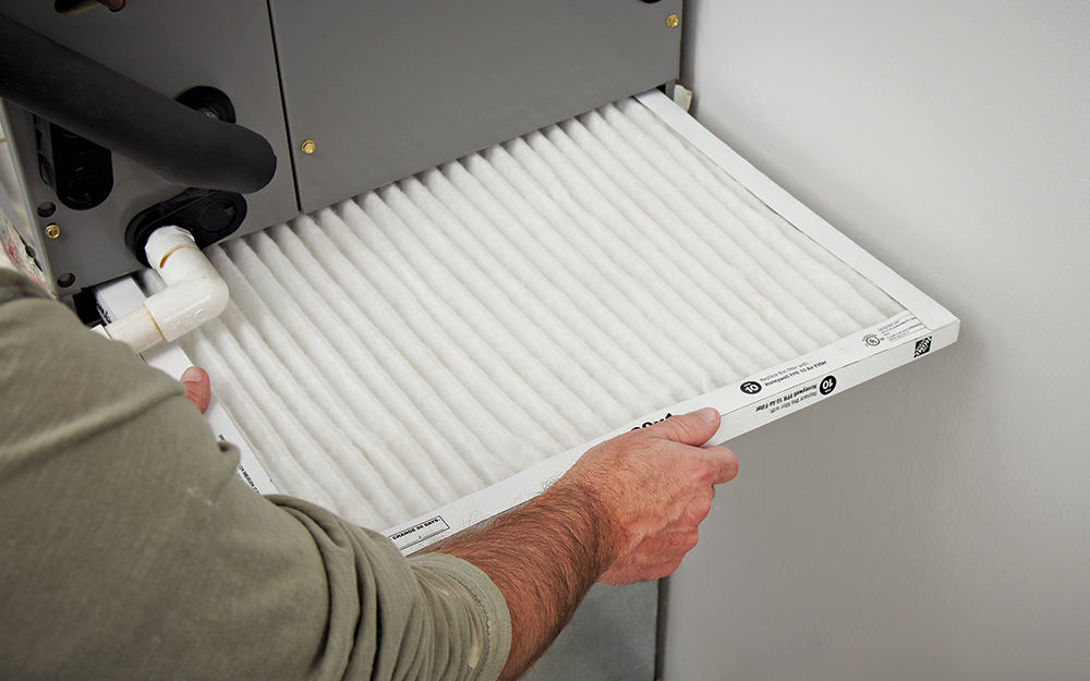 a man installing an air filter