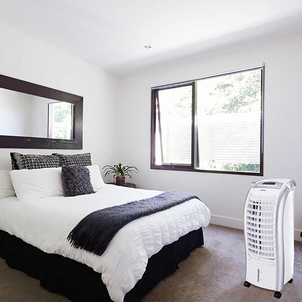 bedroom featuring an evaporative cooler near an open window