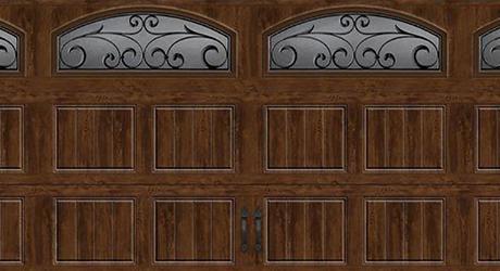 A wooden garage door with windows.