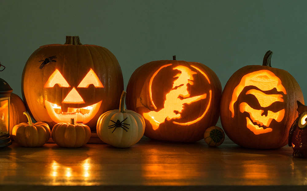Three jack-o'-lanterns with creative designs.