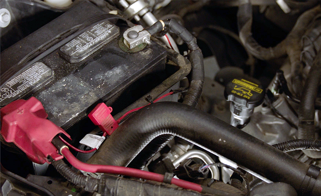 A car battery under the hood.