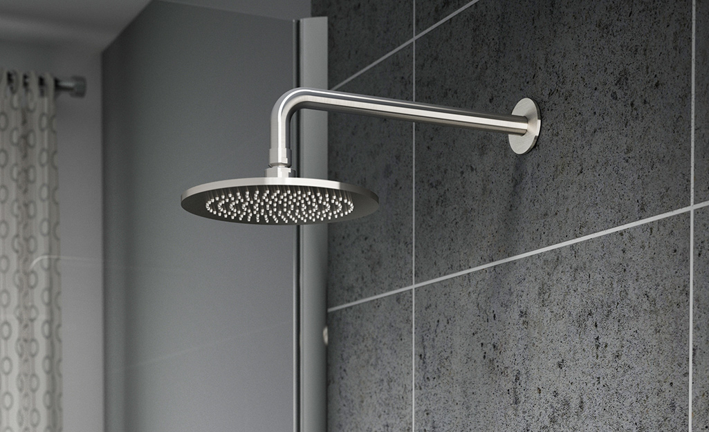 A fixed mount shower head in a shower.