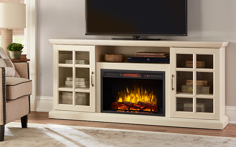 An electric fireplace TV stand against living room wall.