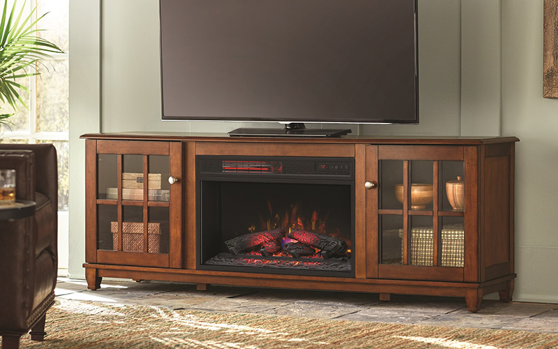 A fireplace TV stand with a flat screen TV placed away from the window to avoid glare.