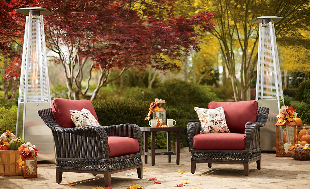Patio heaters in an autumn setting with patio furniture